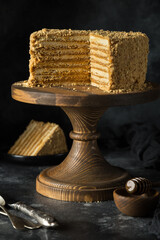 layered homemade honey cake on cake stand