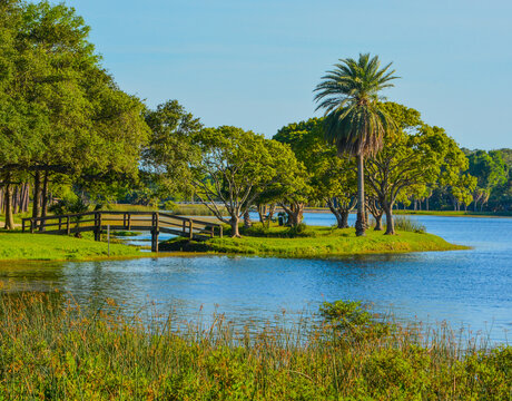 A beautiful day for a walk and the view of the wood bridge to the island at John S. Taylor Park in Largo, Florida.