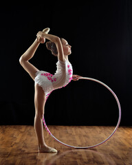 Rhythmic gymnastic girl using a gymnastic ring.