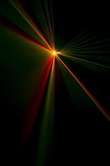 Laser beam tilt orange on a black background