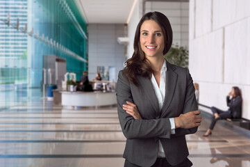 Genuine natural sincere business manager portrait at large lobby area of bank in financial district