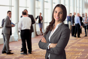 Happy business woman standing in crowd at workshop event with big genuine natural smile