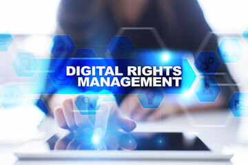 Woman using tablet pc, pressing on virtual screen and selecting digital rights management.