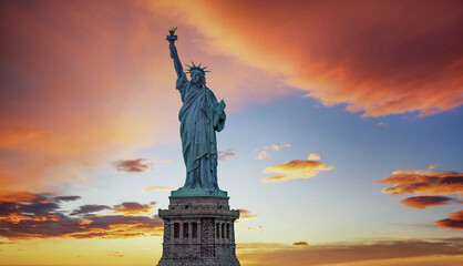 Statue of Liberty with orange sky in the background, New York City