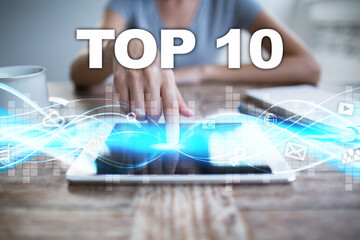 Woman using tablet pc, pressing on virtual screen and selecting top 10.