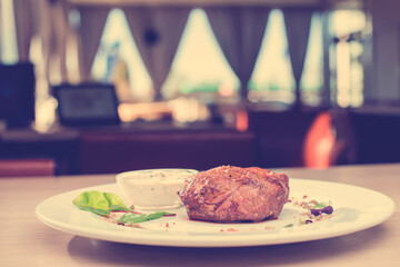 Hot dish steak on the table in a restaurant