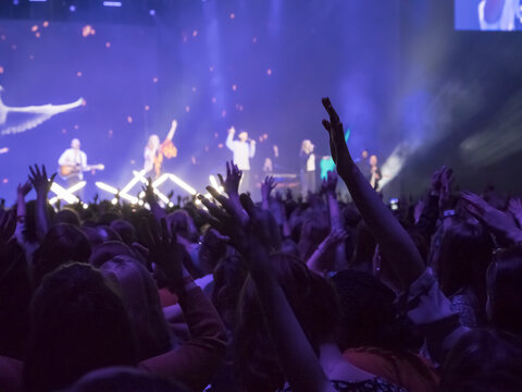 People partying at a concert and enjoying live music.