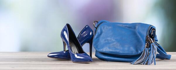 Blue handbag and blue high heel shoes