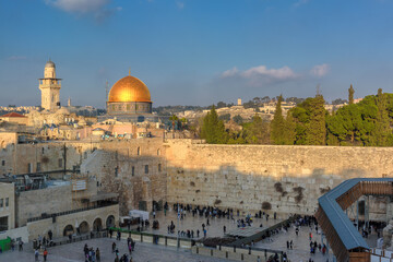 Western Wall and golden Dome of the Rock at sunset in Jerusalem Old City, Israel.