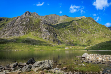 Tryfan is a mountain in the Ogwen Valley, Snowdonia, Wales. It forms part of the Glyderau group,