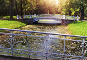 the bridge over the channel overgrown with a duckweed. Catherine Park. Pushkin (Tsarskoye Selo). Petersburg..