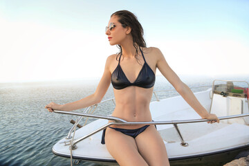 Fit woman on a boat