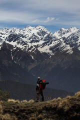Trekker looking to the mighty Himalayas during Rudranath Trek in Uttarakhand, India