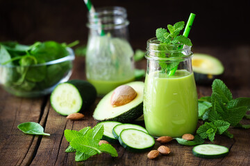 Green detox smoothie with avocado, cucumber, spinach and with fresh mint. Healthy eating, weight loss and dieting concept