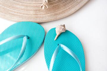 7697d8f20 Blue flip flops straw hat beach wrap on white background