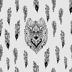 Seamless pattern with wolf and feathers
