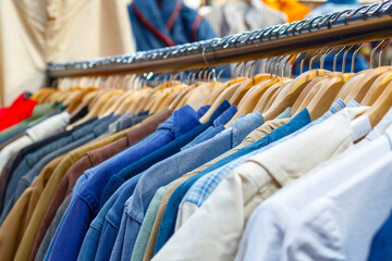 Rail of second-hand clothes on display at Old Spitalfields Market in London
