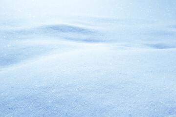 Natural sunny snow drifts background with shades.
