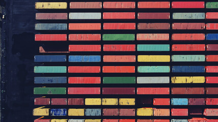Top view aerial photo of freight containers in rows at harbor. Global Logistics Shipping industry. Export and Import transportation services. Cargo container with copy space for shipping brand goods