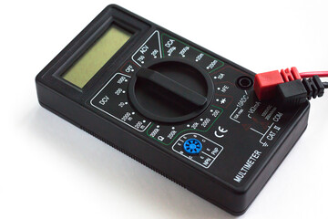 Digital multimeter in a black color casing on white background