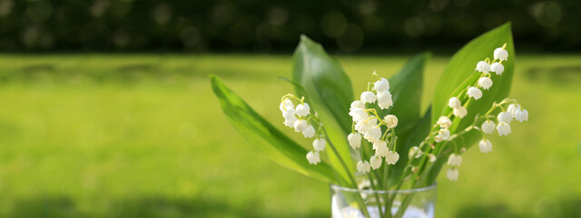 Wall Murals Lily of the valley Lily of the valley bouquet in glas vase.