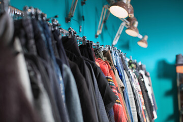 Rack of female clothes in cool shop
