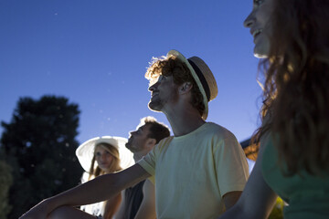 Friends watching starry sky