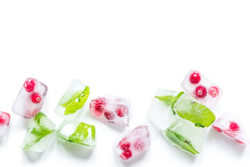 frozen red berries in ice cubes on white background space for text top view