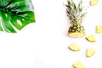 summer mockup with pineapple and leaves white background top view