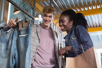 Young couple shopping for jeans
