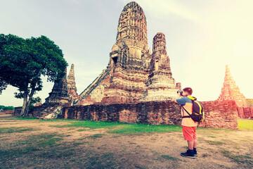 Happy a boy traveler photo by camera