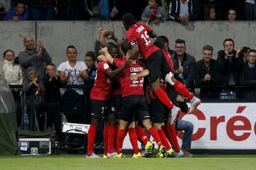 Guingamp's players celebrate the goal of Privat against Olympique Marseille during their French Ligue 1 soccer match at the Roudourou stadium in Guingamp