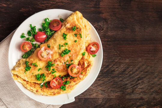 Omelet with parsley, cherry tomatoes, and copyspace