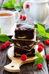 Brownie with raspberries and cheese filling.