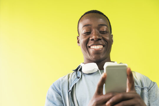 Handsome african man using mobile.