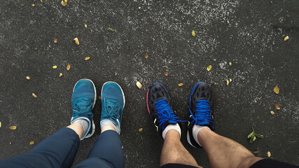 Man and woman wearing sports shoes