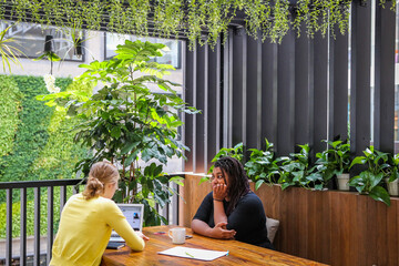 People work together at the Airbnb office headquarters in the SOMA district of San Francisco