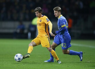 BATE Borisov's Volodko fights for ball with Barcelona's Roberto during their Champions League group E soccer match at Borisov Arena stadium outside Minsk