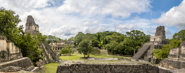 Panoramic view of Mayan Temples of Gran Plaza or Plaza Mayor at Tikal National Park - Guatemala