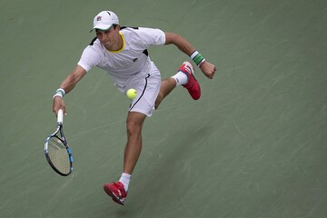 Donskoy of Russia lunges for the ball from Cilic of Croatia during their second round match at the U.S. Open Championships tennis tournament in New York