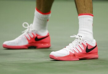 Federer of Switzerland wears his signature shoe from Nike as he plays compatriot Wawrinka during their men's singles semi-final match at the U.S. Open Championships tennis tournament in New York