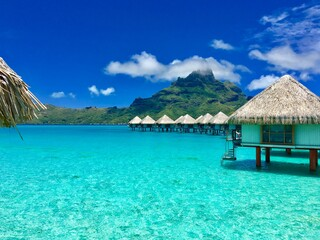 Beautiful turquoise lagoon of Bora Bora and the overwater bungalows of a luxury resort