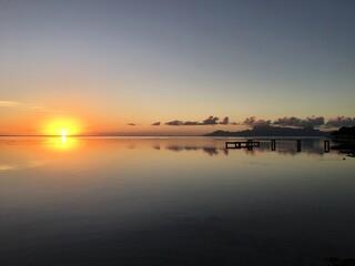 Beautiful sunset at the beach of Punaauia with a beautiful view on Moorea, Tahiti, French Polynesia
