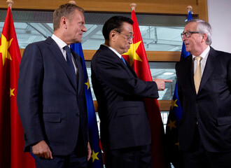 Chinese Premier Li Keqiang reacts alongside EU Commission President Juncker and EU Council President Tusk in Brussels