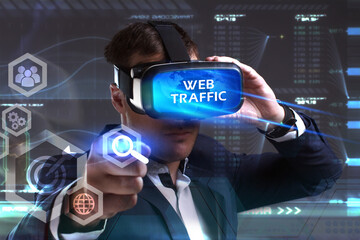 Business, Technology, Internet and network concept. Young businessman working in virtual reality glasses sees the inscription: Web traffic