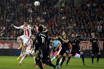 Olympiakos' Luka Milivojevic and Dinamo Zagreb's players jump for the ball during their Champions League group F soccer match at the Karaiskakis stadium in Piraeus