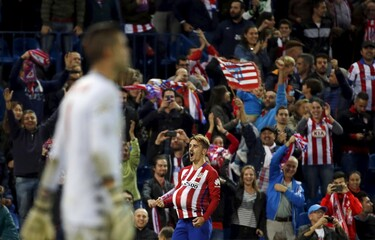 Atletico Madrid's Griezmann celebrates scoring against Sporting Gijon during their Spanish first division soccer match at Vicente Calderon stadium in Madrid