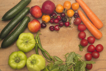 Fresh fruits and vegetables on the wood table
