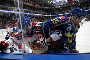 Czech Republic's Buchtele battles Sweden's Sjogren along the boards during their Channel One Cup ice hockey game in Moscow