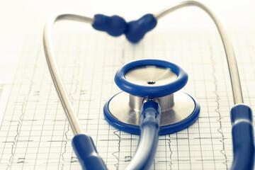 Stethoscope and ekg cardiogram chart - studio shot. Filtered image: cross processed vintage effect.